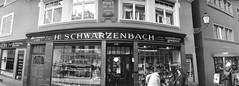 Schwarzenbach Kolonialwaren (schoeband) Tags: bw film coffee 35mm schweiz swinglens zrich ilfordxp2 ch niederdorf panoramiccamera schwarzenbach noblex135u