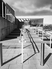 Walk in a straight line.... (Collingwood505) Tags: monochrome metal museum architecture design blackwhite outdoor steel patterns devon exeter granite paving stainless straightlines streetarchitecture