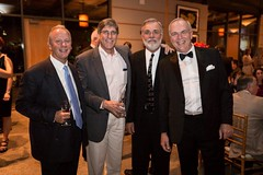 Managing Partner, Clint, and Clients at Saville's 50th Celebration