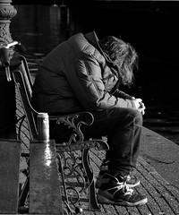 taking a nap... (wojofoto) Tags: sleeping blackandwhite amsterdam bench zwartwit streetphoto alcoholic slapen bankje straatfoto wolfgangjosten wojofoto