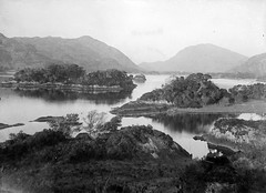 """Lake surrounded by mountains in an unknown location"" (is lakes of Killarney) (National Library of Ireland on The Commons) Tags: landscape islands police killarney glassnegative countykerry upperlake highjinks lakesofkillarney nationallibraryofireland locationidentified fergusoconnor fergusoconnorcollection"