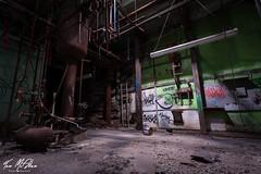 Spotlight (Tom McAdam) Tags: light urban abandoned industry glass dark graffiti paint kentucky empty debris elevator cable eerie warehouse forgotten desolate urbanex