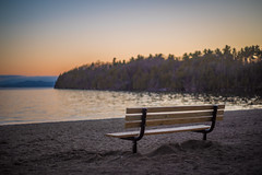 The Lonely Bench (Evan's Life Through The Lens) Tags: camera blue sunset orange sun lake cold color green beach water glass beautiful vintage lens focus friend afternoon waterfront purple minolta bright bokeh walk vibrant f14 sony side sunny front hike lakeside adventure shallow 58mm a7s