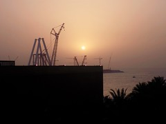 Obstruction? (LumosStar684) Tags: trees light sunset sea summer sun beach coast seaside construction dubai uae cranes coastal unitedarabemirates jumeirah jumeirahbeach