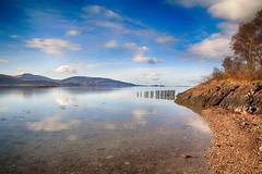 Loch Linnhe (OutdoorMonkey) Tags: sea reflection water coast scotland seaside still bluesky calm coastal serene posts seashore ardgour lochlinnhe