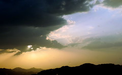 After A Storm (Khaled M. K. HEGAZY) Tags: blue sunset sky orange cloud sun white mountain black nature silhouette yellow closeup nikon outdoor coolpix ksa kingdomofsaudiarabia p520
