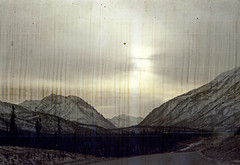 30-082 (ndpa / s. lundeen, archivist) Tags: road winter sky sun snow mountains color fall film ice 30 alaska clouds 35mm landscape nick scratches spots 1970s damaged scratched 1972 distressed ontheroad snowcovered alaskan dewolf discolored heatdamage damagednegative nickdewolf photographbynickdewolf reel30