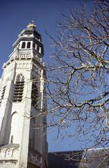 Bare branches and a church tower (Wouter de Bruijn) Tags: tower film church architecture analog mediumformat kodak gothic churchtower 6x9 160vc portra middelburg 160nc langejan