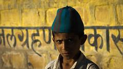 Schoolboy - Writing on the Wall (Henrik Ladegaard-Pedersen) Tags: city school india hat wall writing sam muslim hindi rajasthan rajasthani schoolboys