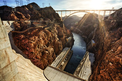 Power Hungry (Brian Truono Photography) Tags: bridge arizona lake southwest history nature water rock river concrete flow nationalpark energy power desert control lasvegas nps dam nevada dry canyon helicopter wires valley hooverdam lakemead coloradoriver electricity government gorge tall produce geology region source arid hdr highdynamicrange regional renewable geological nationalhistoricsite exposureblending