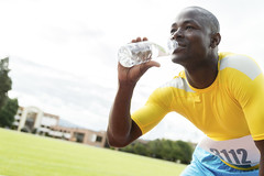Fit man drinking water (The Nile Basin Initiative Secretariat) Tags: park people man black male guy sports water race speed outdoors person athletics track drink drinking lifestyle competition running run africanamerican athlete jogging fitness runner sprint adults challenge fit trackandfield competitive plasticbottle sprinter hydration runningtrack healthylifestyle sportsrace sportstrack africandescent sportstraining