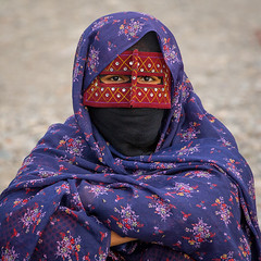 a bandari woman wearing a traditional mask called the burqa at panjshambe bazar thursday market, Hormozgan, Minab, Iran (Eric Lafforgue) Tags: portrait people woman beauty square outdoors persian clothing eyes asia veil mask iran muslim islam religion hijab culture persia headshot hidden covered iranian bazaar adults adultsonly oneperson traditionaldress burqa customs ethnicity middleeastern frontview sunni burka chador youngadultwoman balouch hormozgan onewomanonly lookingatcamera burqua  bandari  embroidering 1people  iro thursdaymarket  minab colourpicture  borqe panjshambebazar boregheh iran034i2588