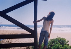 How to explain that sensation of going down the shore and barely having a couple of fishermen far in the distance? (Hijo de la Tierra.) Tags: old travel boy sea summer selfportrait film nature analog 35mm uruguay longhair shore santateresa rocha hijodelatierra