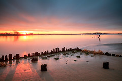 Rise and... (Rob Mintzes) Tags: nyc longexposure bridge light sky newyork beach nature water clouds sunrise landscape bay coast sand ruins glow shadows waterfront decay queens shore decaying waterscape jamaicabay