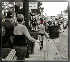 Aug 7 2011 - Tattoo advertising on her back at Sturgis (lazy_photog) Tags: ladies black photography women south rally bikes class tattoos harley hills lazy babes motorcycle races davidson dakota deadwood sturgis elliott bikers photog