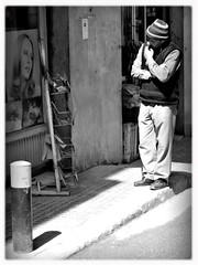 (l.khatchikian) Tags: street blackandwhite streetphotography pensive newsstand shopkeeper