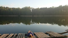 Lake reflection 2 (modestmoze) Tags: travel blue trees summer sky brown white reflection green broken nature girl yellow clouds forest outside outdoors wooden girlfriend warm shadows relaxing sunny deck lying treeline chill lak
