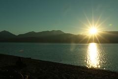sun setting at Cogburn Beach, Harrison Lake, BC (sergeyangelina) Tags: water landscape glare shine hills rays