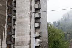 Do you have a lighter? (Raphs) Tags: trees green wet rain fog clouds facade dark concrete grey schweiz switzerland cables balconies zrich trist raphs triemli residentialbuilding wiedikon tamronspaf1750mmf28xrdiiildaspherical canoneos70d
