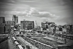 Bustle of the City (Silverio Photography) Tags: street city urban blackandwhite boston photoshop canon cityscape elements pancake 24mm hdr zakim topaz adjust primelens massachuetts 60d