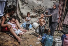 Salwa Abu Nemer washes her daughter Asma (TeamPalestina) Tags: sunset sky sun sunrise landscape landscapes photo am amazing nice photographer natural sweet live palestine comfort sunrays gaza beautifull palestinian  landscapecaptures