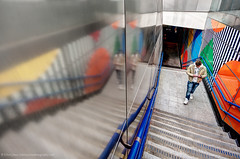 Reflected Digital Focus (Edwinjones) Tags: pictures city uk light england people urban color colour building london art geometric architecture stairs photoshop underground subway hall artwork pattern metro sony escalator tube skylight entrance sigma wideangle indoor symmetry ceiling diagonal smartphone tiles tubestation londonunderground exit atrium topaz undergroundstation buildingstructure