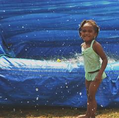 Splash (alexiscooperphotography) Tags: portrait water childhood photoshop photography splash waterslide funtimes pooltime childrensworld childrenphotography childrenfun nikond3100