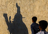shadow on an adobe wall of the groom riding his camel during a wedding ceremony, Qeshm Island, Salakh, Iran (Eric Lafforgue) Tags: wedding shadow people boys childhood animal silhouette horizontal kids children outdoors photography asia iran muslim islam traditional ceremony culture traditions marriage persia folklore celebration camel custom cultures 2people twopeople cultural islamic middleeastern persiangulf sunni qeshmisland hormozgan إيران bandari иран childrenonly イラン irão straitofhormuz 伊朗 unrecognizableperson colourpicture 이란 salakh iran034i9450