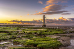 Just another lighthouse (Dancin K & H) Tags: camera new uk blue sunset sky lighthouse holiday seaweed green beach clouds landscape nikon rocks brighton wirral merseyside