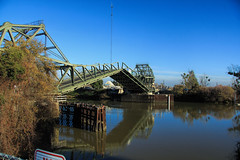 Draw bridge in the Calif. Delta. (Walt Barnes) Tags: bridge water canon river eos japanese boat yacht chinese delta calif drawbridge locke sacramentoriver topaz levee walnutgrove pleasurecraft 60d canoneos60d eos60d topazclarity topazinfocus wdbones99