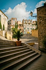 Stairs (Markus Finke Blickfelder.com) Tags: italien sky italy color colour clouds stairs town mediterranean availablelight sony streetphotography himmel wolken stairway stadt alpha farbe treppen 7s warmcolors mittelmeer gemuer vorhandeneslicht warmefarben blickfeldercom