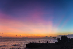 alive (maikepiel) Tags: ocean light sunset sea sky people bali beach water strand indonesia evening abend licht rocks meer wasser colours sonnenuntergang silhouettes himmel menschen rays sunrays indonesien felsen strahlen