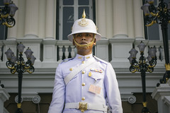 King's Guard (tylerkingphotography) Tags: city travel portrait white lens thailand photography nikon uniform southeastasia king photographer post outdoor bangkok helmet guard royal kingdom grand palace explore backpacking thai kit 1855mm traveling amateur guardian pith thronehall kingsguard chakrimahaprasat d3100 royalthaiarmedforces