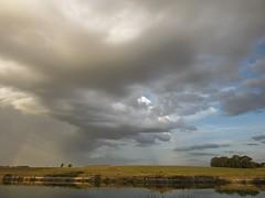 Dramatismo celestial (naomikean) Tags: naturaleza argentina arcoiris ro rboles paisaje cielo nubes tormenta campos ribera necochea roquequn