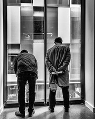 Left:Right (Baz:Matthews) Tags: people man blancoynegro home window manchester mono blackwhite theatre candid humour frombehind behind twopeople peoplewatching lookingout bendingover twomen streetcandid homemanchester bazmatthews