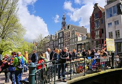 Pancakes for 1   at the Bloemgracht (Bn) Tags: street party feest people music orange holiday holland water netherlands beer colors dutch amsterdam festival heineken boat topf50 kiss kissing king singing dancing market smoke free floating bikes kingdom swing canals celebration national trendy muziek carnaval prinsengracht alexander mokum gezellig amstel maxima willem jordaan oranje crowded westertoren straat westerkerk wester feestdag grachtengordel panden 50faves 27april koningsdag kingsday dansmuziek