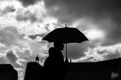 contrast (Valentino Belloni) Tags: street blackandwhite france silhouette contrast umbrella 35mm nikon noiretblanc bordeaux streetphotography parapluie gironde