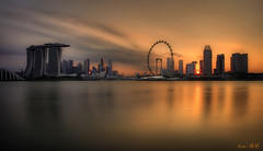 Last shot of the sun (Ken Goh thanks for 2 Million views) Tags: blue sunset sky sun reflection water silhouette skyline golden singapore pentax smooth sigma rays 1020 citiscape marinabarrage gardenbythebay k5iis