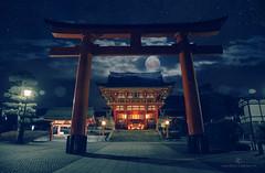 Fushimi-ku in Kyoto (Denis Carbone) Tags: longexposure blue red moon japan night clouds stars landscape asian kyoto gate shrine colorful asia fotograf photographer outdoor fullmoon nippon torii shintoshrine redgate eastasia  haiden inarishrine fushimiku canon5dmarkiii
