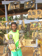 Danny with his Wood Carvings, Abuakwa, Ashanti Region, Ghana, Feb. 9, 2016 (Daniel Kerkhoff) Tags: road wood school daniel international lincoln danny carvings kerkhoff sunyani abuakwa