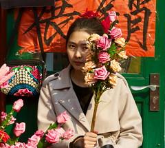 Flower seller Liulichang Beijing (Bruce in Beijing) Tags: girl beijing springfestival liulichang flowerseller xichengdistrict