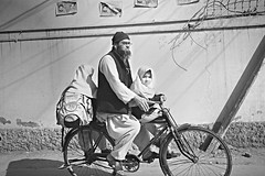 Pakistani Girls going to school (Nasir Khan) Tags: school bicycle education oldman younggirls pakistanigirlseducation