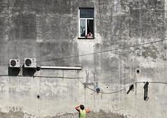 Window. (tetyanabunyak) Tags: house window wall wire women gray poland conversation airconditioning jarosaw