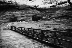Glencoe Cottage ( Jamie Mitchell) Tags: road wood uk bridge trees winter white snow black building film monochrome grass weather scotland frost path cottage scottish hut glencoe tones scots tonal wintry