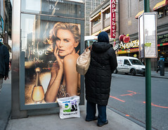j'adore (UrbanphotoZ) Tags: nyc newyorkcity ny newyork skyline reflections shopping bag model waiting applebees manhattan busstop midtown jeans blonde passenger westside dior jadore duanereade skicap quiltedcoat