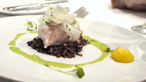 Baked Fraser River sturgeon over black quinoa, saffron, poached baby turnips, shaved fennel, parsley emulsion
