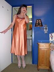 Looking at the bed (Paula Satijn) Tags: orange hot sexy girl silver shiny pumps silk tgirl tranny transvestite heels satin gurl silky nightdress nightie