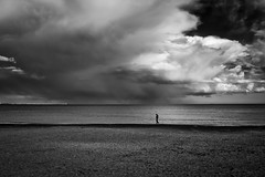 Lonely (Georgi C) Tags: street sea people storm beach rain clouds landscape sand streetphotography stormy bulgaria rainy lonely burgas lonelypeople yahoo:yourpictures=weather