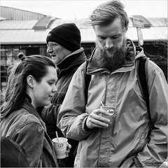 Is it the coffee? (John Riper) Tags: park street people bw white man black netherlands coffee monochrome hat canon john hair square beard photography mono rotterdam couple zwartwit candid go drinking knot l dizzy bun carfree 6d 24105 straatfotografie kleinpolderplein autoloos riper johnriper