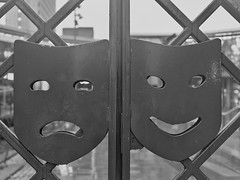 Sadness and Happiness (MySimplePhotosToday) Tags: uk england urban blackandwhite bw art monochrome rain sadness woking gate symbol unitedkingdom happiness shoppingcentre surrey theme southeast raining drama